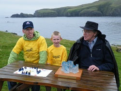 Grandmaster Peter Kelly (right) with  2010 Junior champion Dean Thomason and 2010 Senior Champion Tim Millar. Tim a glass sculptor, presented Fetlar Hnefatafl Panel with an impressive Trophy for the annual competition.