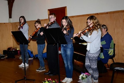 Fiddle Attraction entertain at the hall