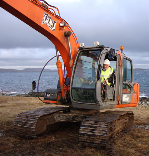 Josie Simpson cutting first turf for New fetlar Pier and breakwater